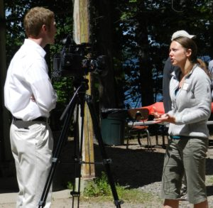 Sam Oliver providing limnological expertise for the local nightly news crew at Trout Lake Station